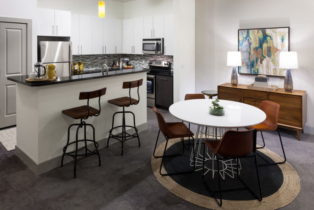 Dining room and kitchen at Maple District Lofts in Dallas, Texas