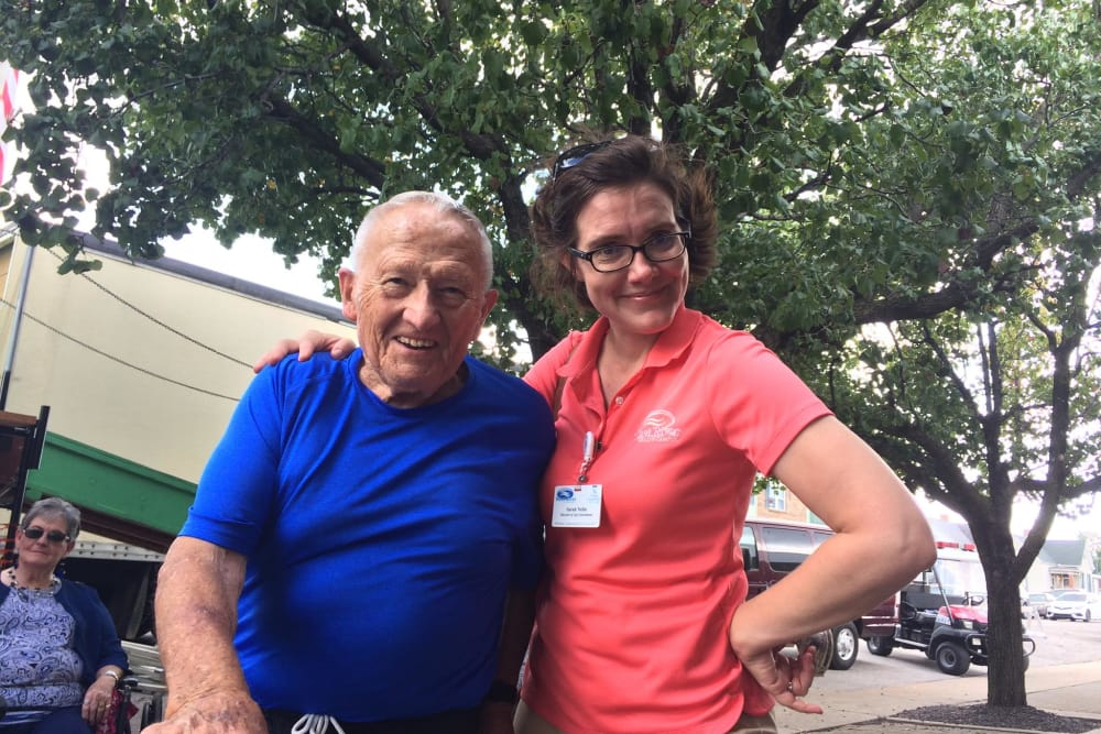 A resident and caretaker from West River Health Campus in Evansville, Indiana outside