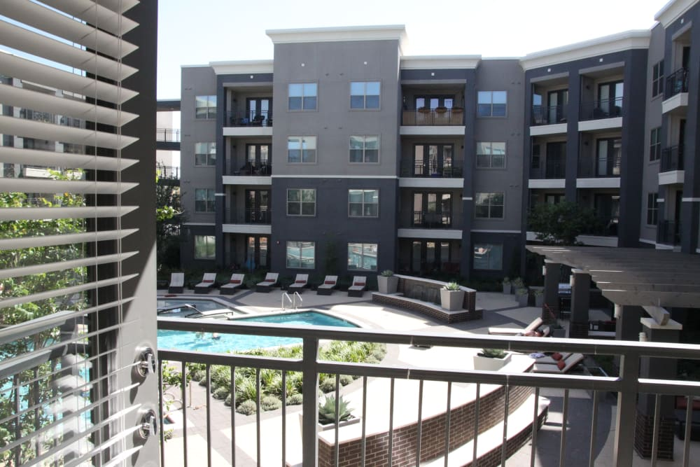 Private patio with a view of the pool at Axis at Wycliff in Dallas, Texas