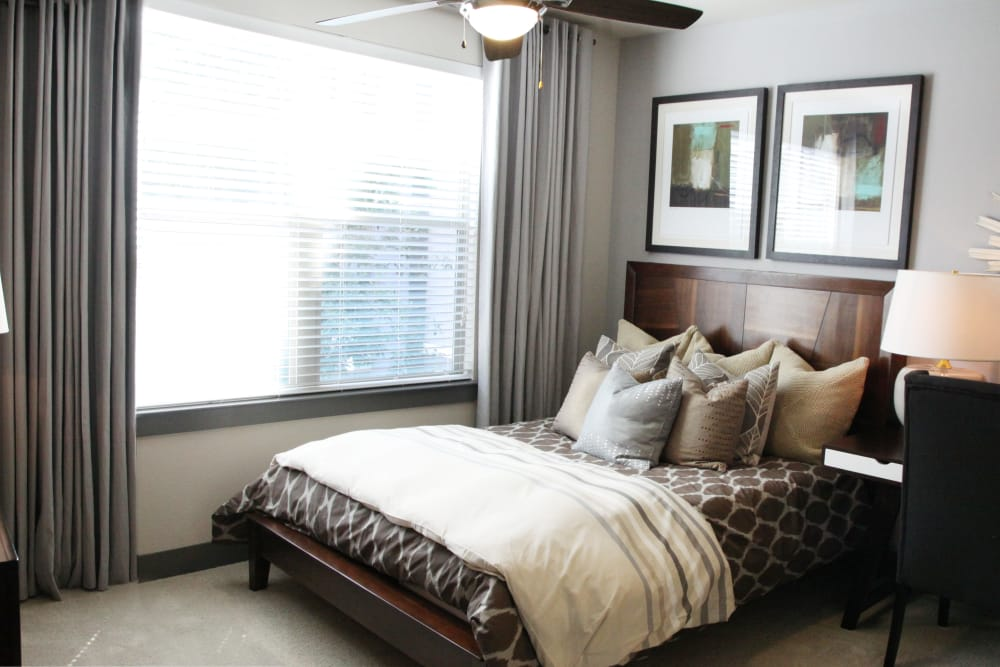 Bright bedroom at Axis at Wycliff in Dallas, Texas