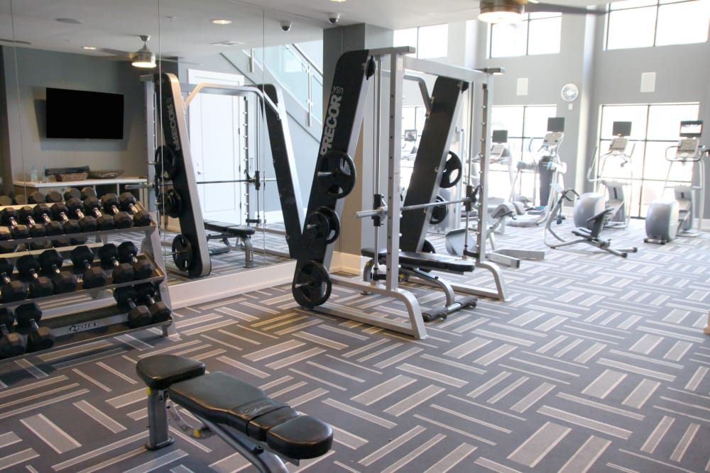 Fully equipped fitness center at Axis at Wycliff in Dallas, Texas