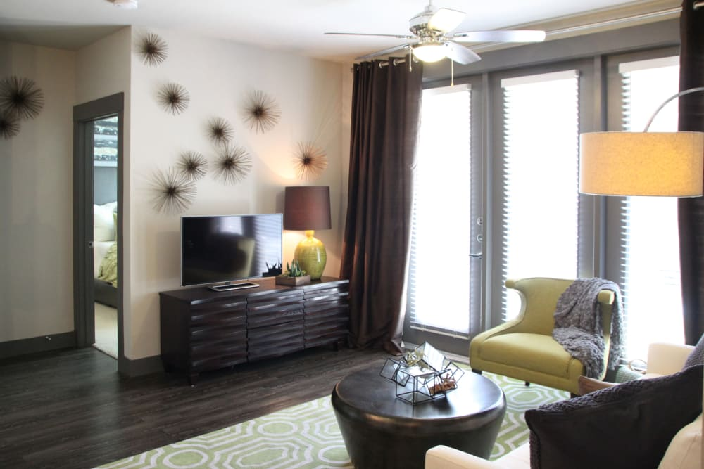 Living room with patio access at Axis at Wycliff in Dallas, Texas