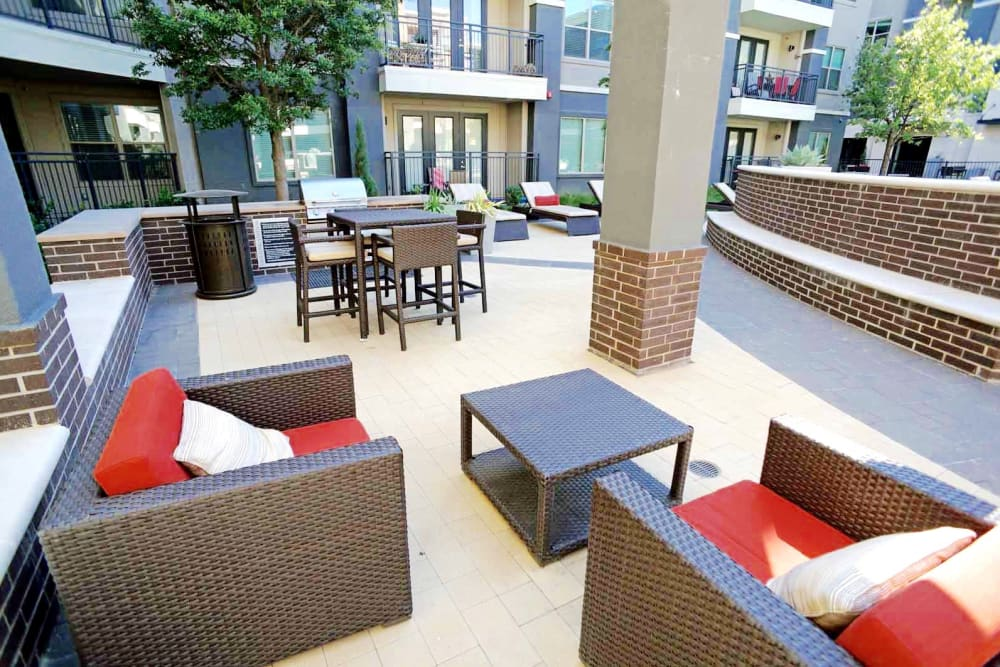 Outdoor lounge area at Axis at Wycliff in Dallas, Texas