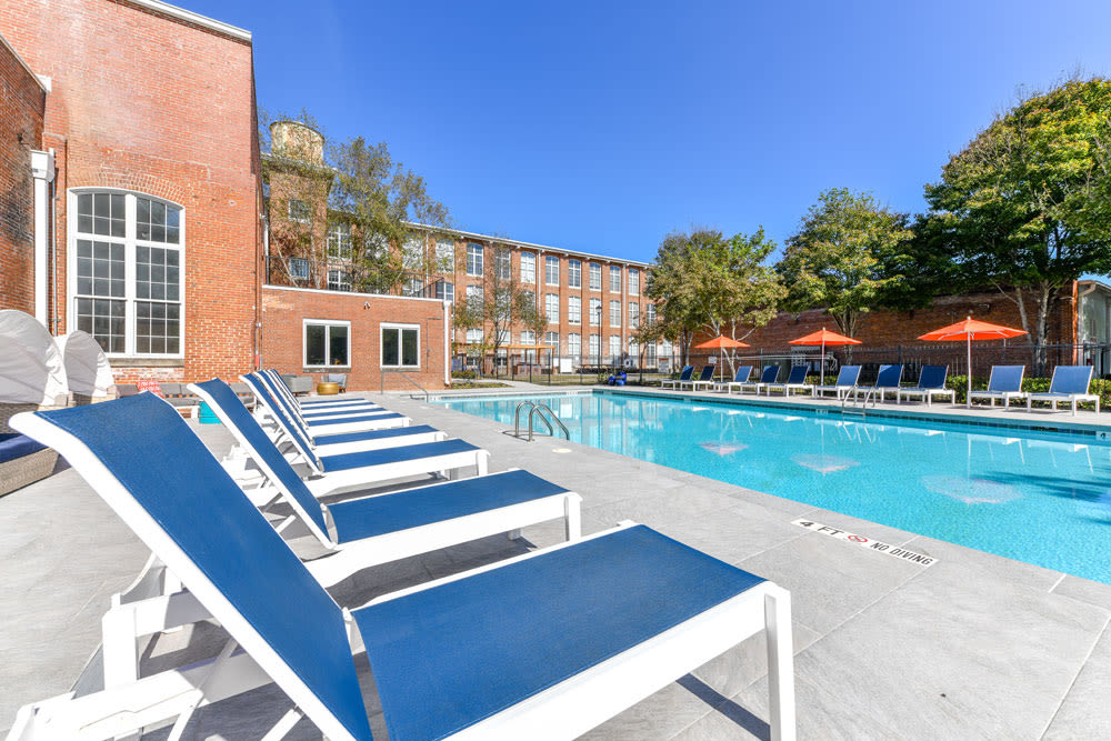 Seating next to pool at Canton Mill Lofts in Canton, Georgia