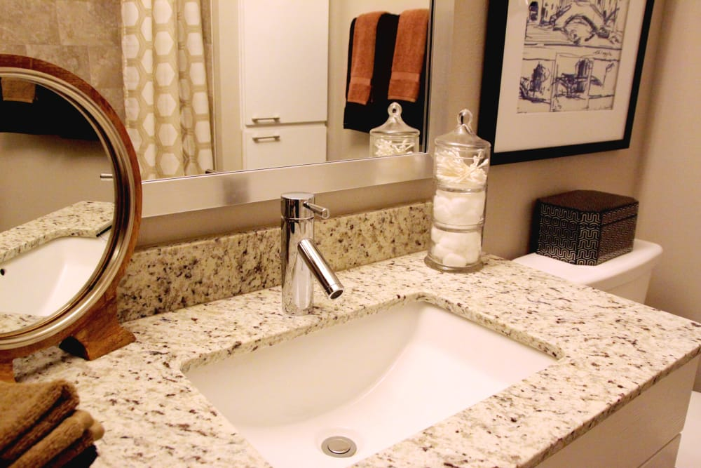 Bathroom sink at Axis at Wycliff in Dallas, Texas