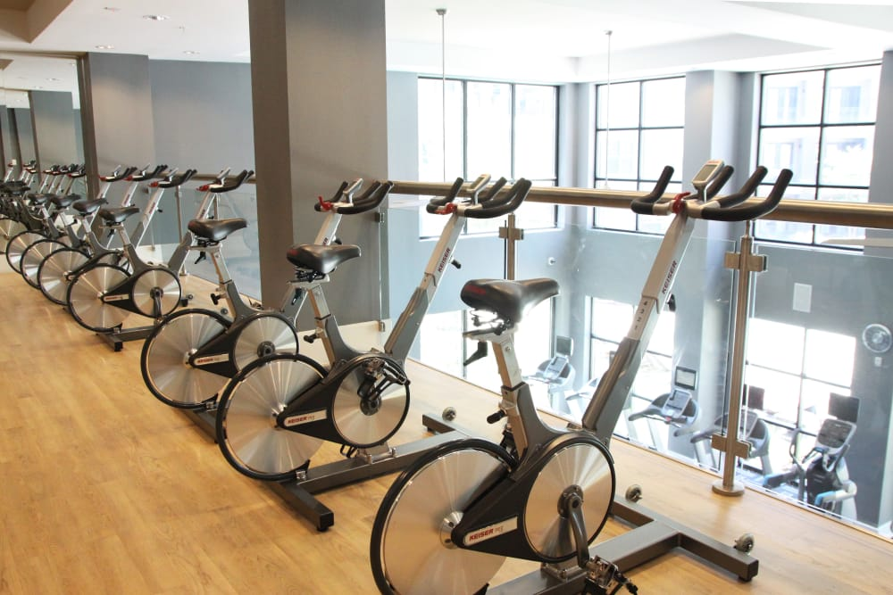 Indoor fitness center at Axis at Wycliff in Dallas, Texas
