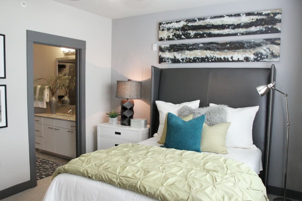 Well decorated bedroom at Axis at Wycliff in Dallas, Texas