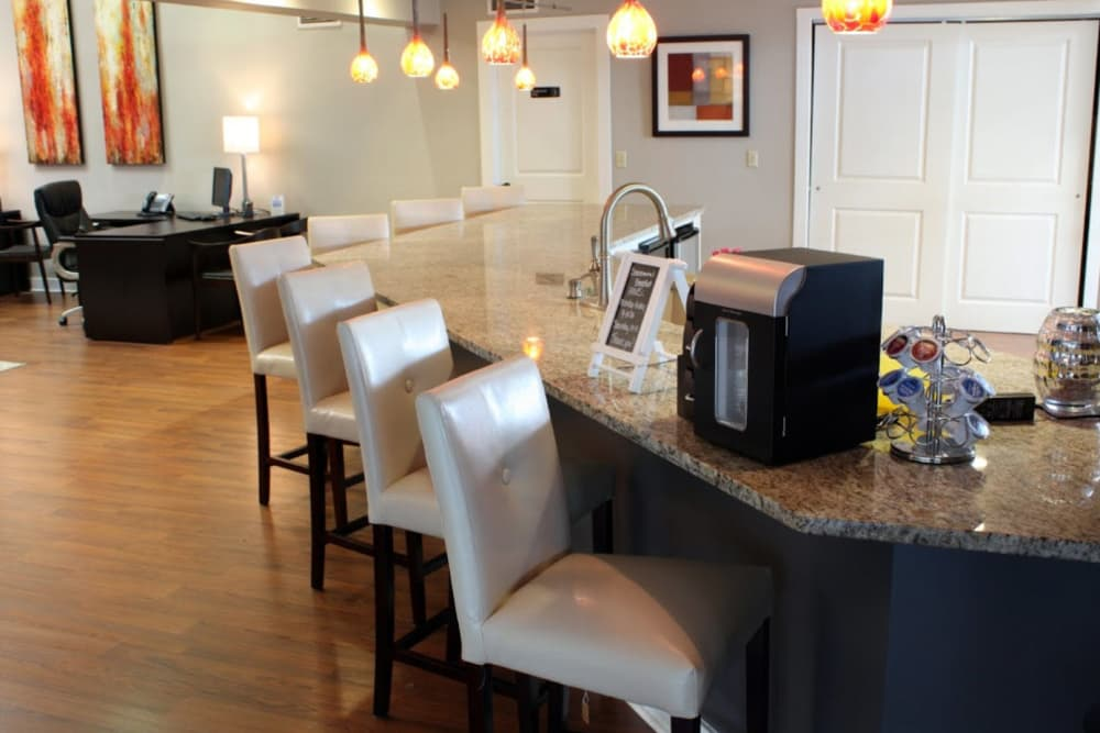 The resident clubhouse with comfortable bar seating at Goldelm at Metropolitan in Knoxville, Tennessee