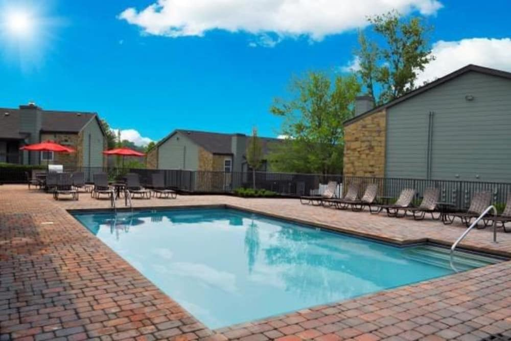 An outdoor swimming pool at Goldelm at Metropolitan in Knoxville, Tennessee