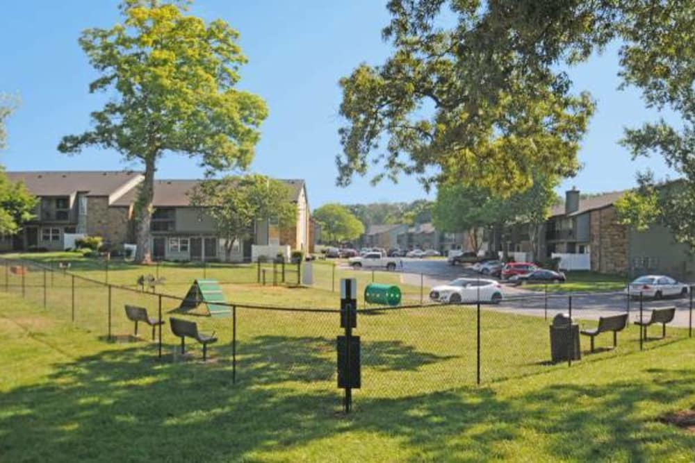 A large grass lawn for your pups to play at Goldelm at Metropolitan in Knoxville, Tennessee