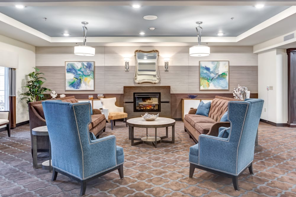Cozy fireside seating in the lounge at The Springs at Stony Brook in Louisville, Kentucky