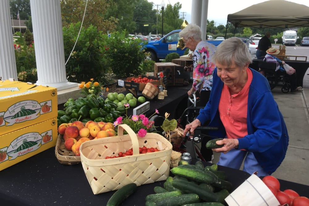Resident shopping for produce near Westport Place Health Campus in Louisville, Kentucky
