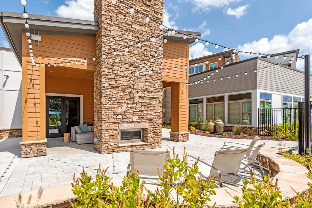 Rock fireplace with seating at Flats At 540 in Apex, North Carolina