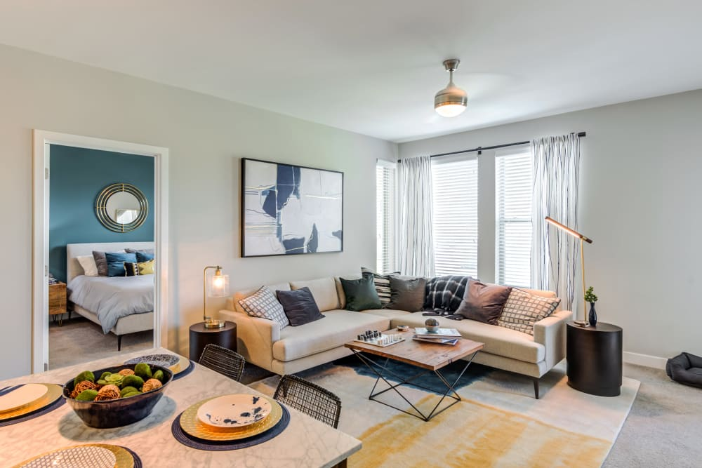 Large living room with ample lighting at Flats At 540 in Apex, North Carolina