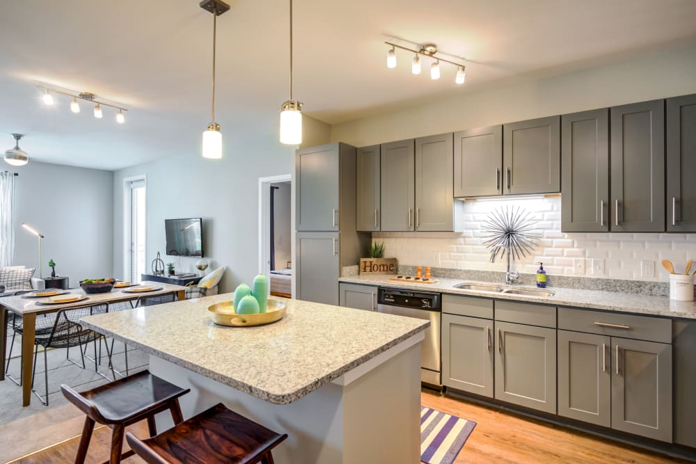 Gorgeous kitchen with great lighting at Flats At 540 in Apex, North Carolina