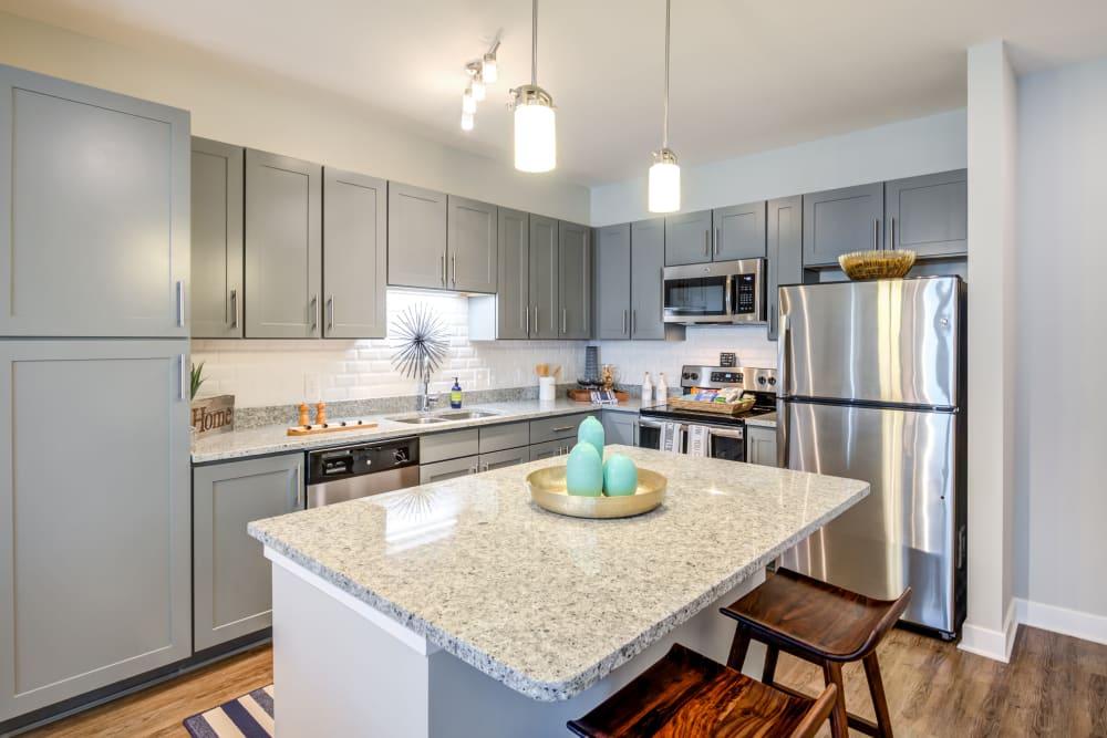 Beautiful kitchen with island at Flats At 540 in Apex, North Carolina