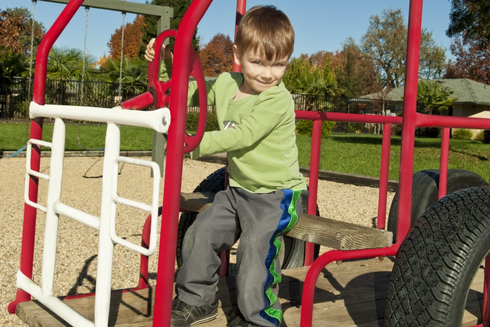 Child playing on the playground at Mission Ranch Apartments in Chico, California