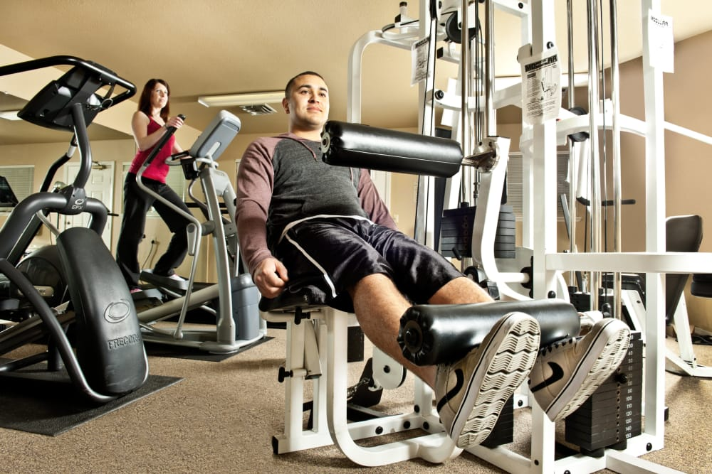 Two residents working out in the fitness center at Mission Ranch Apartments in Chico, California