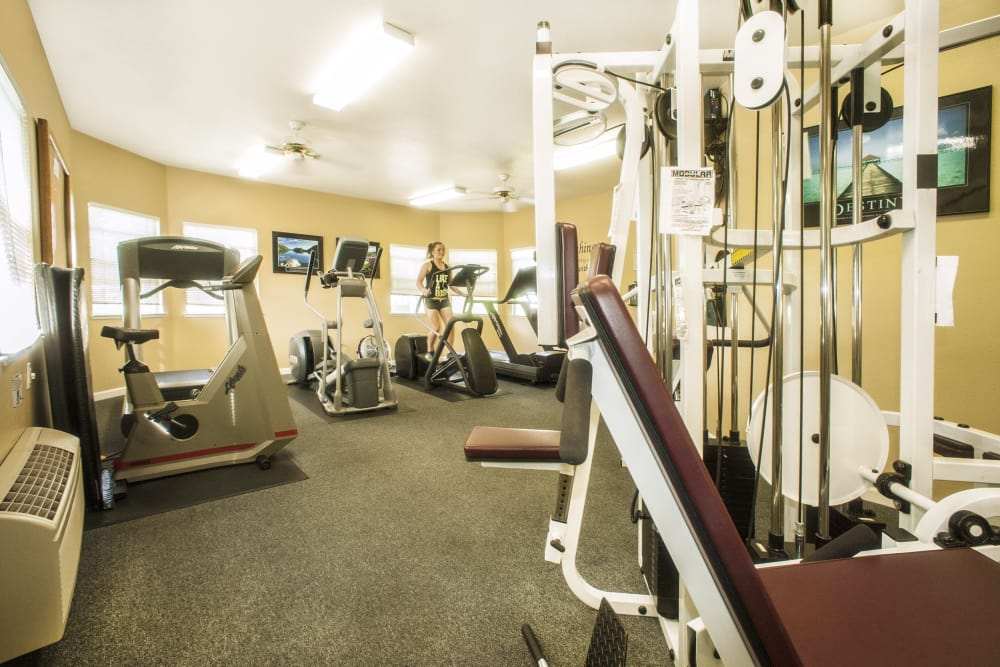 Fitness center with work out equipment at Mission Ranch Apartments in Chico, California
