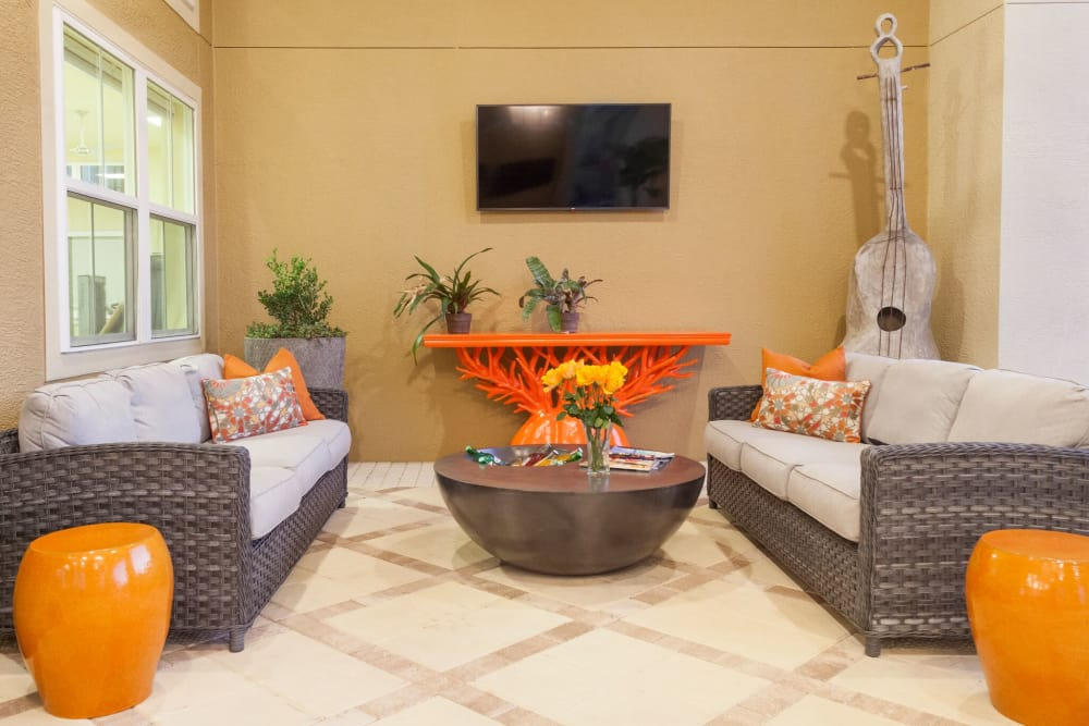 Seating and TV at The Gate Apartments in Champions Gate, Florida