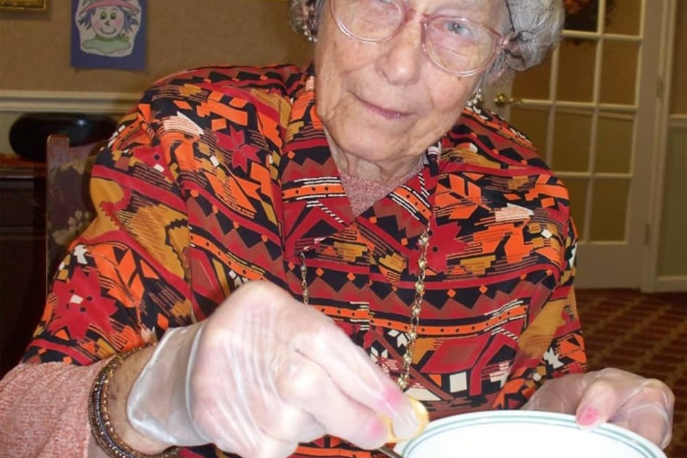 Resident working with some glue at Heritage Hill Senior Community in Weatherly, Pennsylvania