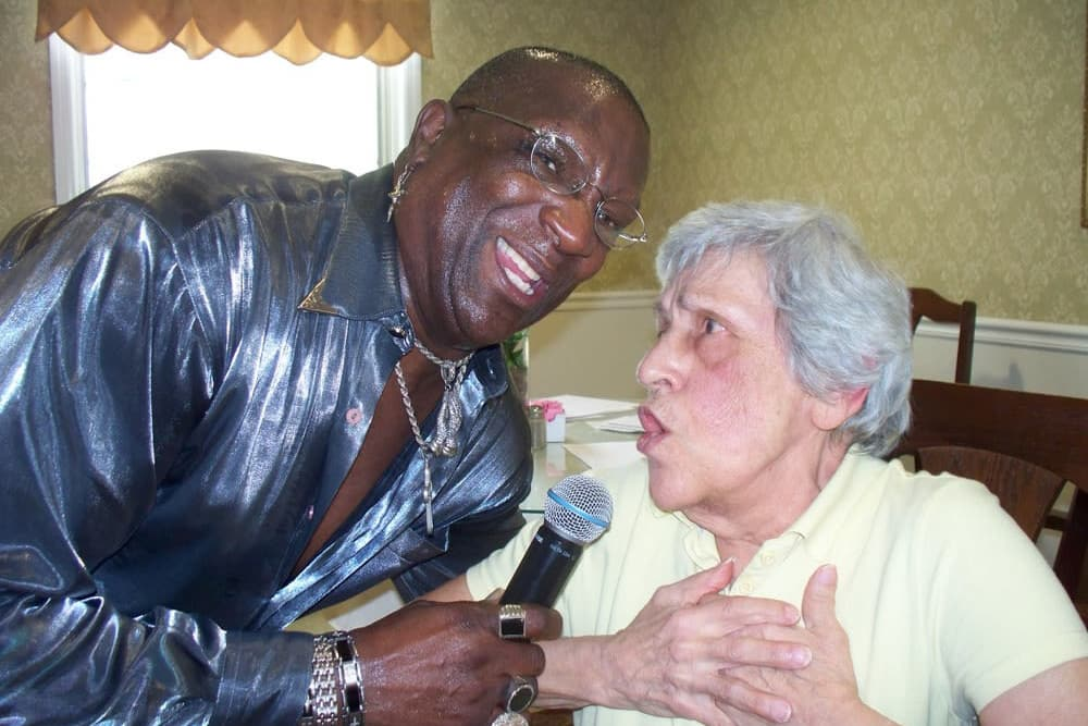 Resident singing with a caretaker at Heritage Hill Senior Community in Weatherly, Pennsylvania