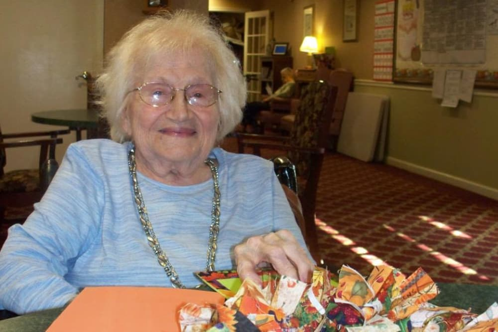 Resident with arts supplies at Heritage Hill Senior Community in Weatherly, Pennsylvania