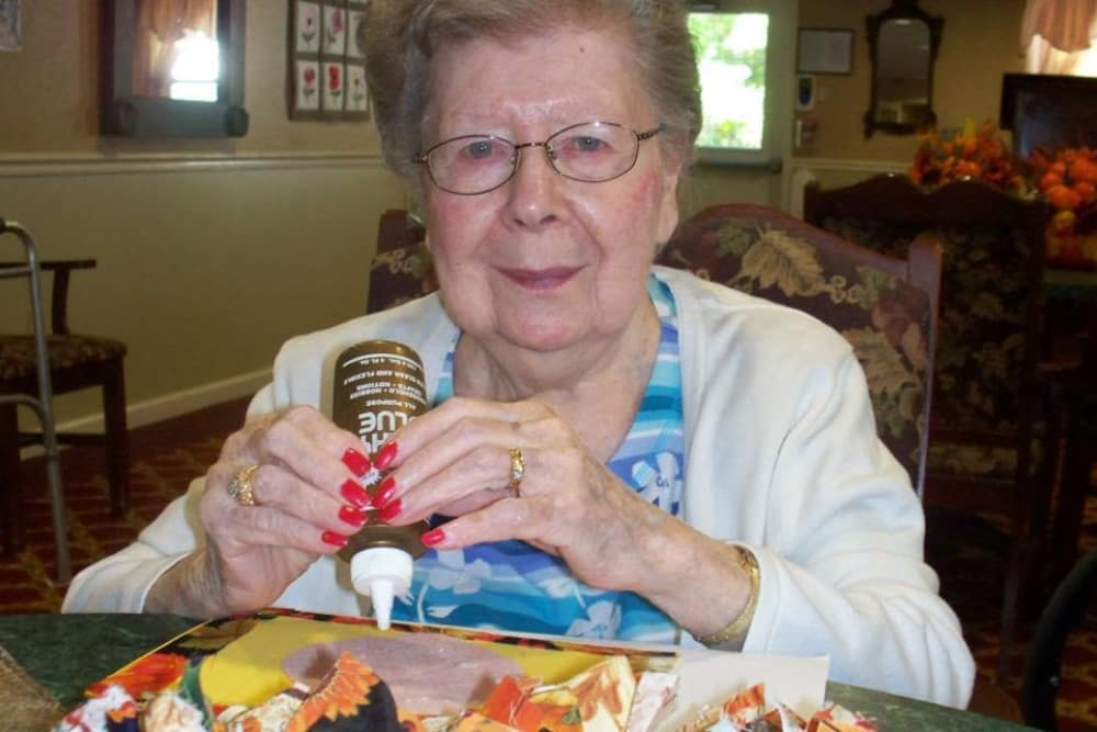 Resident making a festive piece at Heritage Hill Senior Community in Weatherly, Pennsylvania
