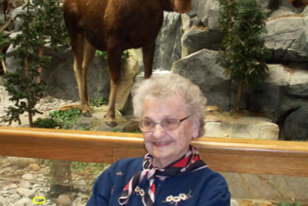 Resident standing in front of a moose exhibit at Heritage Hill Senior Community in Weatherly, Pennsylvania