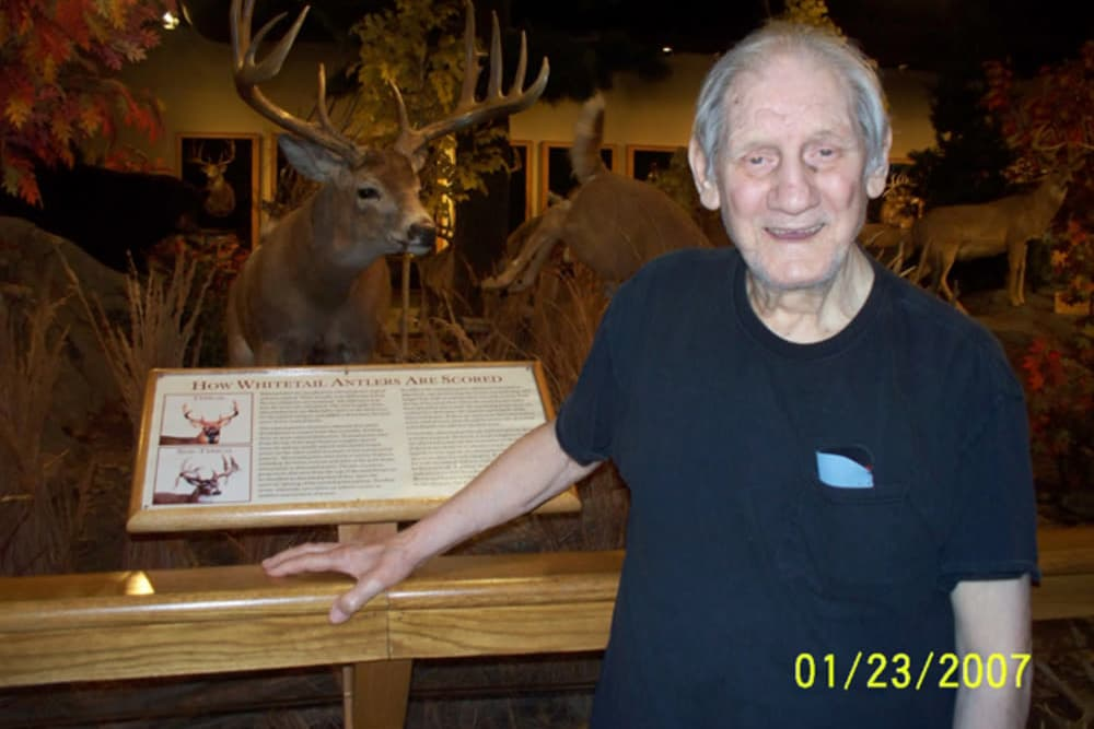 Resident at the museum posed in front of a deer exhibit near Heritage Hill Senior Community in Weatherly, Pennsylvania