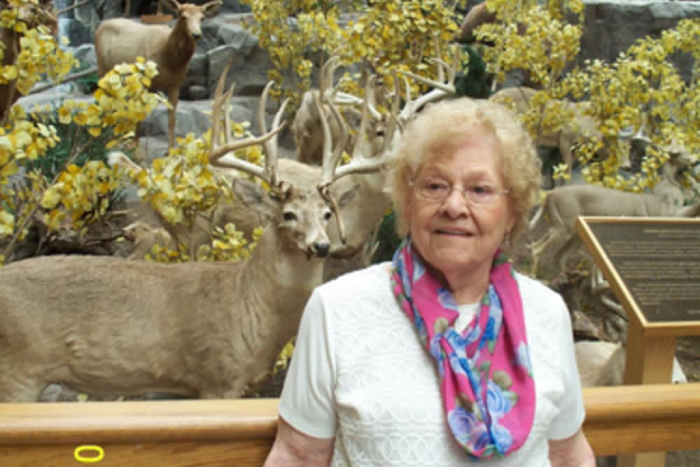 Resident standing in front of a white tailed buck exhibit at Heritage Hill Senior Community in Weatherly, Pennsylvania