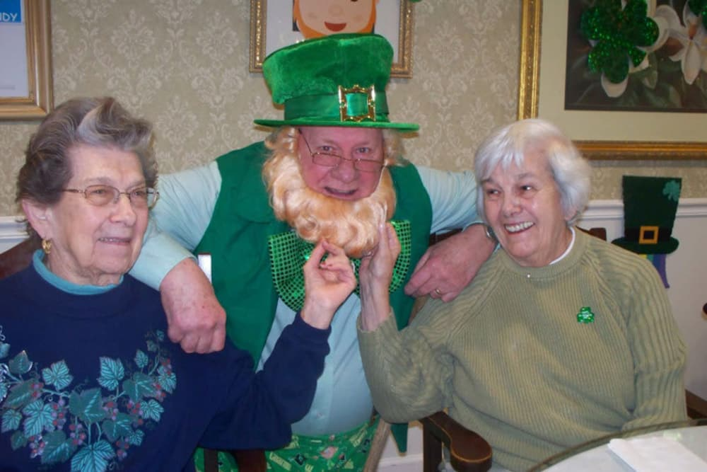 two residents posing with a man dressed as a leprechaun at Heritage Hill Senior Community in Weatherly, Pennsylvania
