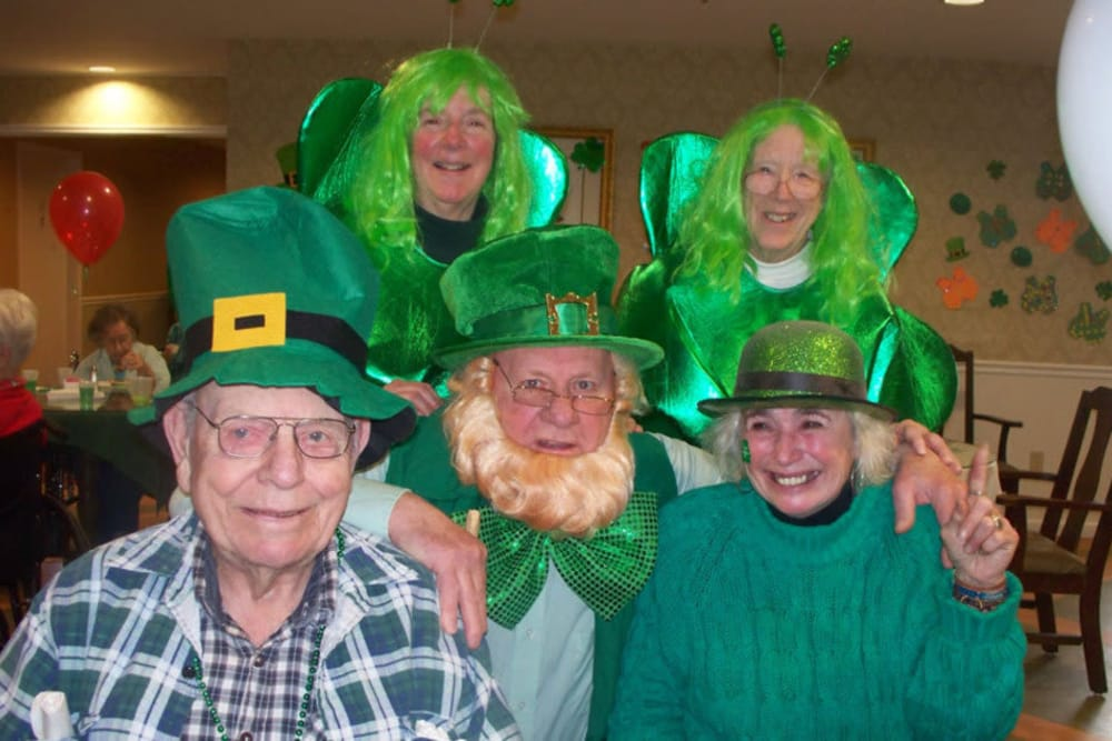 Group of residents with the man dressed as a leprechaun at Heritage Hill Senior Community in Weatherly, Pennsylvania