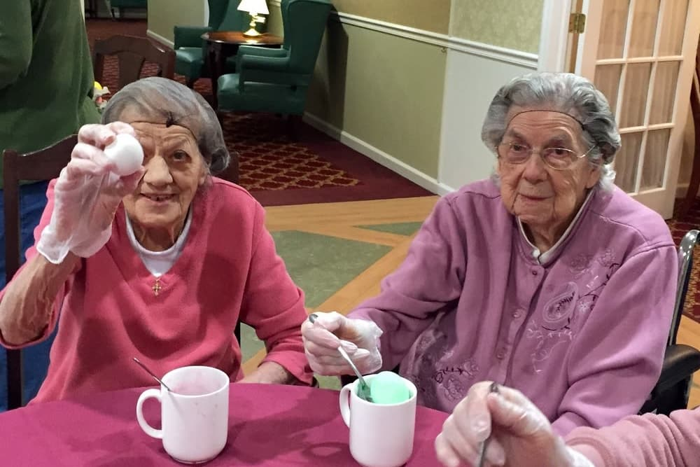 Two residents painting eggs at Heritage Hill Senior Community in Weatherly, Pennsylvania