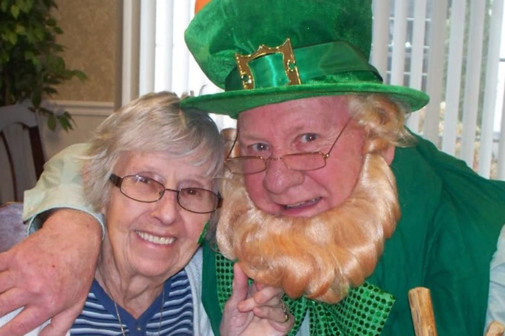 another resident posing with a man dressed as a leprechaun at Heritage Hill Senior Community in Weatherly, Pennsylvania