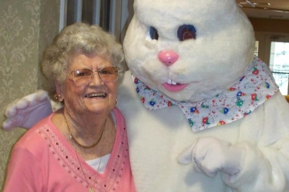 woman posing with a person in an easter bunny outfit at Heritage Hill Senior Community in Weatherly, Pennsylvania