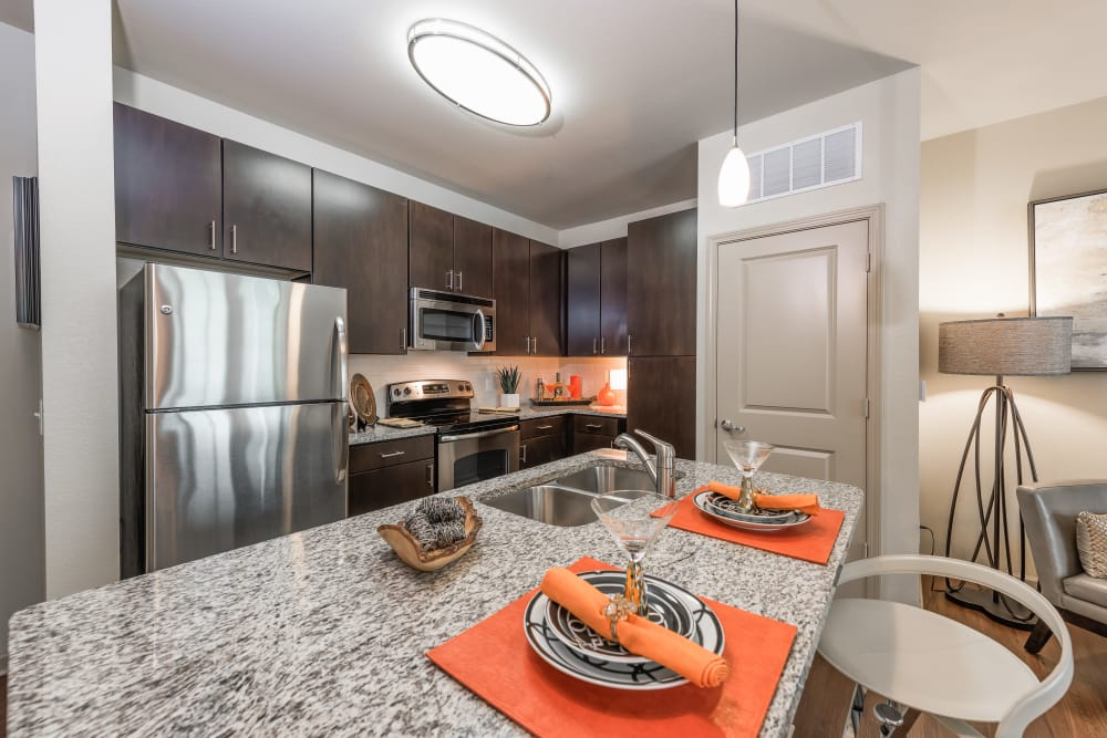 Kitchen and place setting at Jefferson Westshore in Tampa, Florida