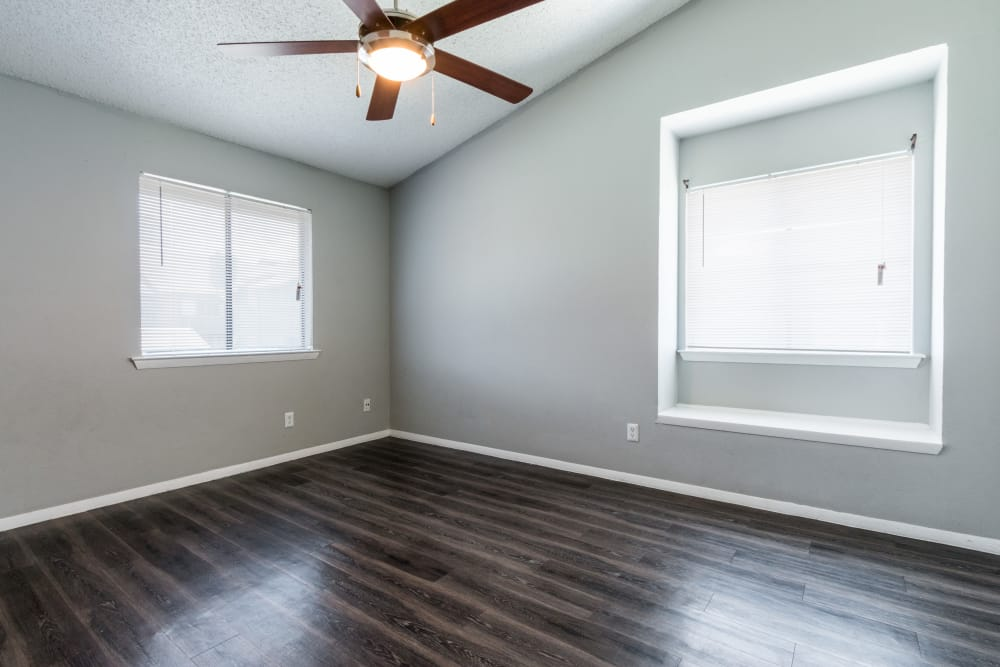 Wood flooring and a ceiling fan in a bedroom at Northchase Apartments in Austin, Texas