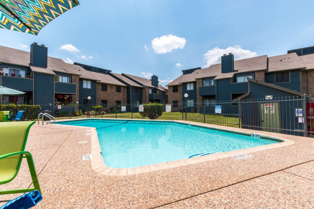 The community pool with seating for residents at Northchase Apartments in Austin, Texas