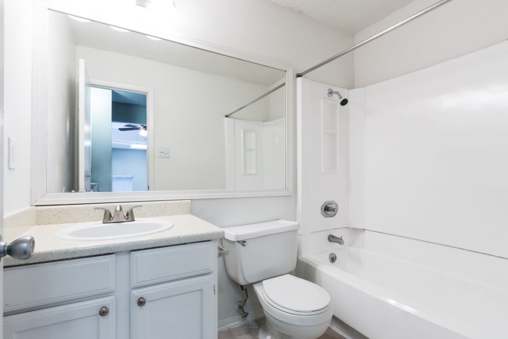 An apartment bathroom with a bathtub at Northchase Apartments in Austin, Texas