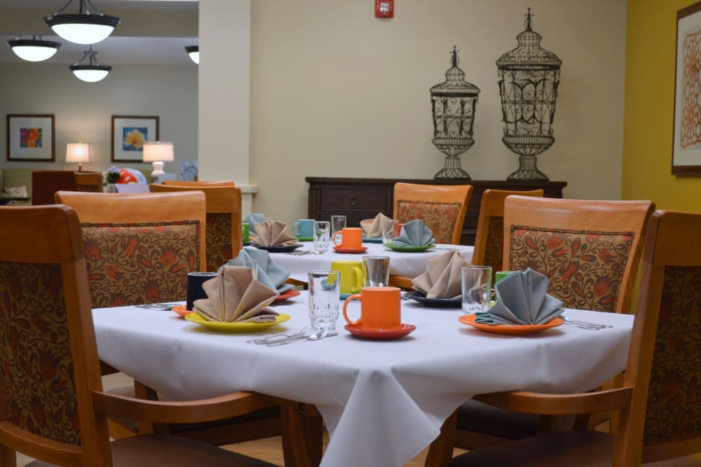 A well decorated dining room table at Avenir Memory Care at Little Rock in Little Rock, Arkansas
