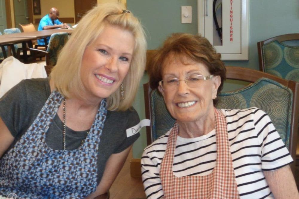 Two smiling residents at Avenir Memory Care at Chandler in Chandler, Arizona