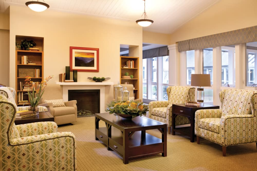 Common area with fireplace at Avenir Memory Care at Knoxville in Knoxville, Tennessee.