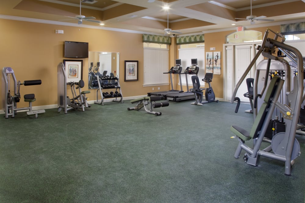 Exercise equipment in fitness center at Villa Grande on Saxon in Orange City, Florida