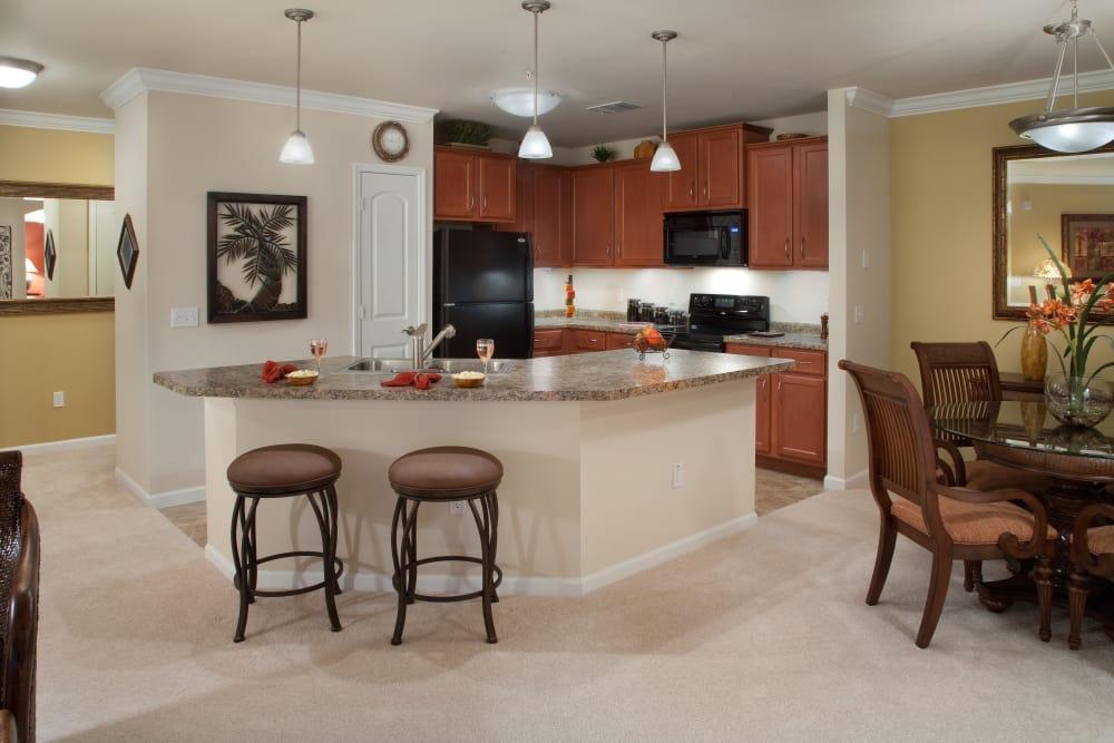 Bar stools at bar in model home in Orange City, Florida at Villa Grande on Saxon