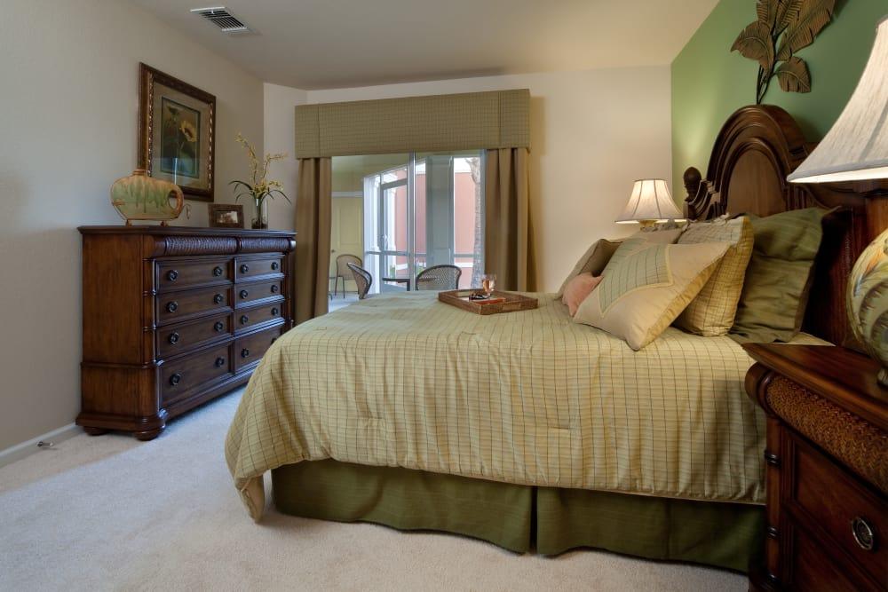 Furnished master bedroom in model home at Villa Grande on Saxon in Orange City, Florida