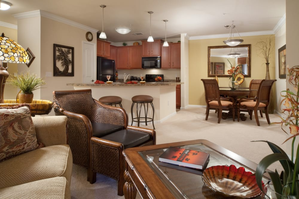 Dining room and living room in apartment at Villa Grande on Saxon in Orange City, Florida