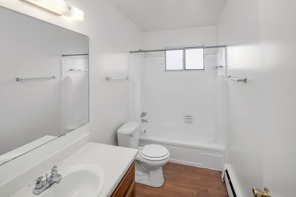 A bathroom with a bathtub at Concorde Club Apartments in Romulus, Michigan