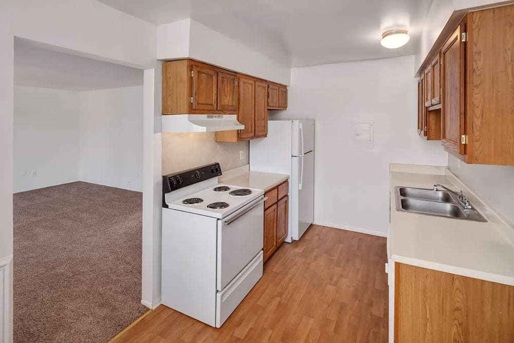 Ana apartment kitchen with wood flooring at Concorde Club Apartments in Romulus, Michigan