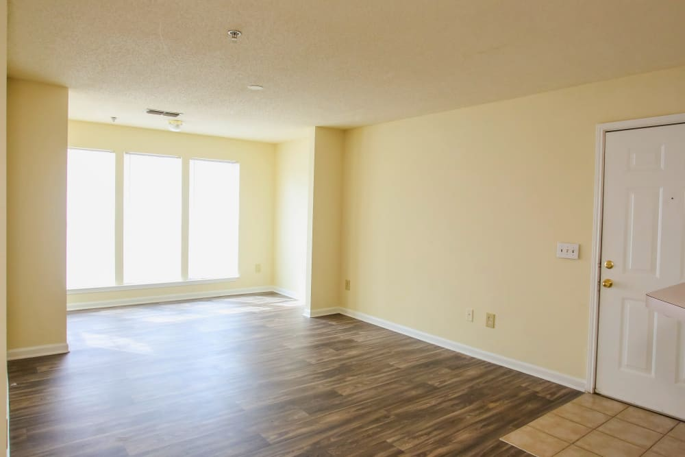The front door of an apartment leads to the living room at Paces Landing Apartments in Gainesville, Georgia
